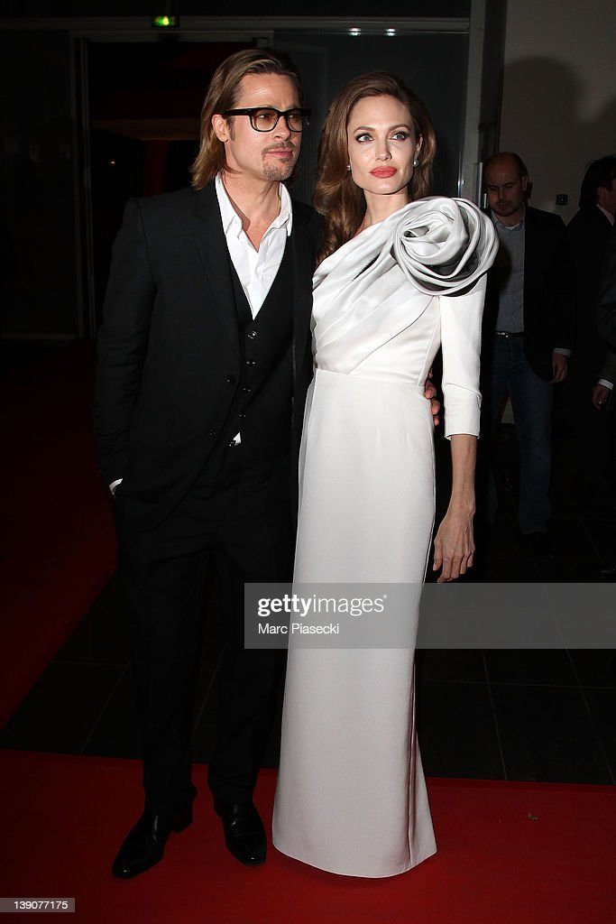 Brad Pitt and Angelina Jolie attend the 'In the Land Of Blood And Honey' Premiere on February 16, 2012 in Paris, France.