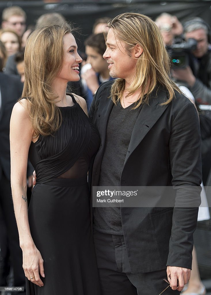 <a gi-track='captionPersonalityLinkClicked' href=/galleries/search?phrase=Brad+Pitt+-+Actor&family=editorial&specificpeople=201682 ng-click='$event.stopPropagation()'>Brad Pitt</a> and <a gi-track='captionPersonalityLinkClicked' href=/galleries/search?phrase=Angelina+Jolie&family=editorial&specificpeople=201591 ng-click='$event.stopPropagation()'>Angelina Jolie</a> attend the World Premiere of 'World War Z' at The Empire Cinema on June 2, 2013 in London, England.