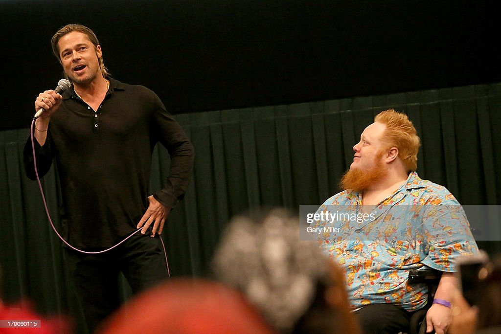 Brad Pitt (L) and Harry Knowles introduce 'World War Z' during a special screening hosted by Ain't It Cool News at the Regal Westgate Theater on June 6, 2013 in Austin, Texas.