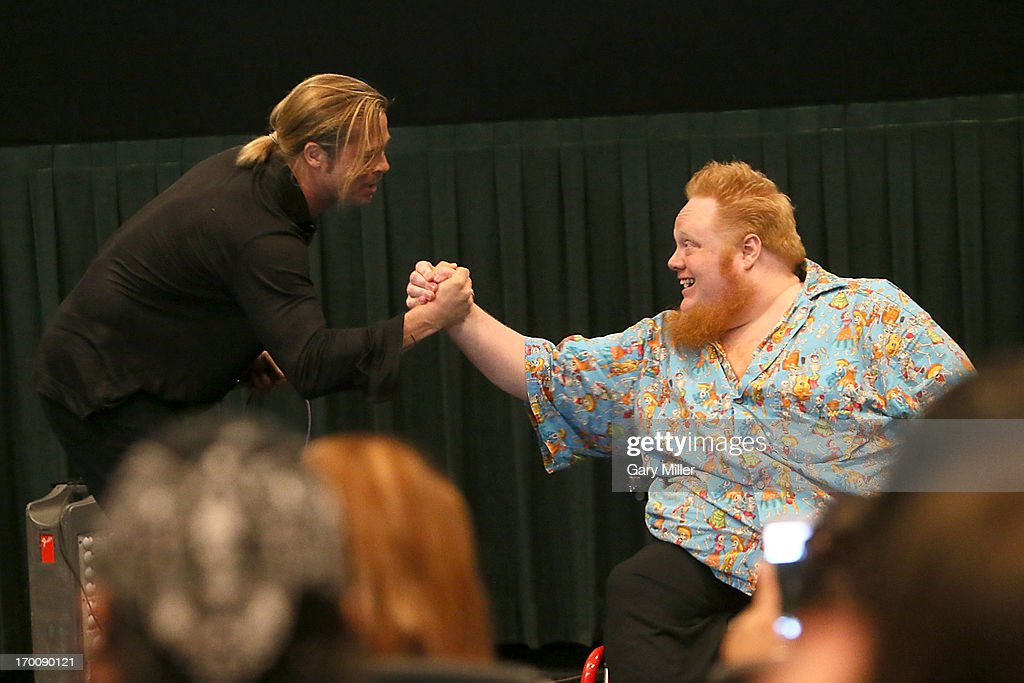 <a gi-track='captionPersonalityLinkClicked' href=/galleries/search?phrase=Brad+Pitt+-+Actor&family=editorial&specificpeople=201682 ng-click='$event.stopPropagation()'>Brad Pitt</a> (L) and Harry Knowles introduce 'World War Z' during a special screening hosted by Ain't It Cool News at the Regal Westgate Theater on June 6, 2013 in Austin, Texas.