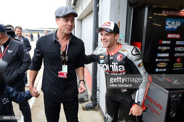 Brad Pitt and Stefan Bradl attend the MotoGP British Grand Prix race at Silverstone ahead of the release of documentary Hitting The Apex Pitt is...