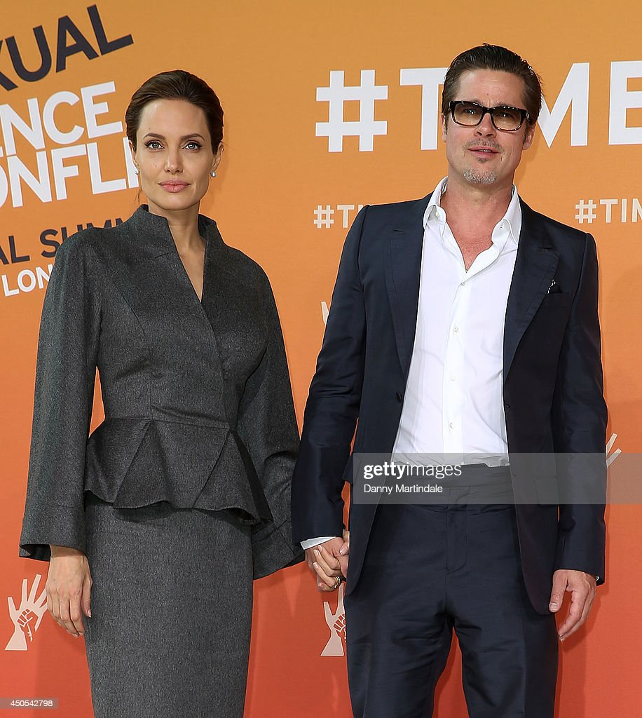 <a gi-track='captionPersonalityLinkClicked' href=/galleries/search?phrase=Brad+Pitt+-+Actor&family=editorial&specificpeople=201682 ng-click='$event.stopPropagation()'>Brad Pitt</a> and US actress and UN special envoy <a gi-track='captionPersonalityLinkClicked' href=/galleries/search?phrase=Angelina+Jolie&family=editorial&specificpeople=201591 ng-click='$event.stopPropagation()'>Angelina Jolie</a> attend the Global Summit to end Sexual Violence in Conflict at ExCel on June 13, 2014 in London, England.