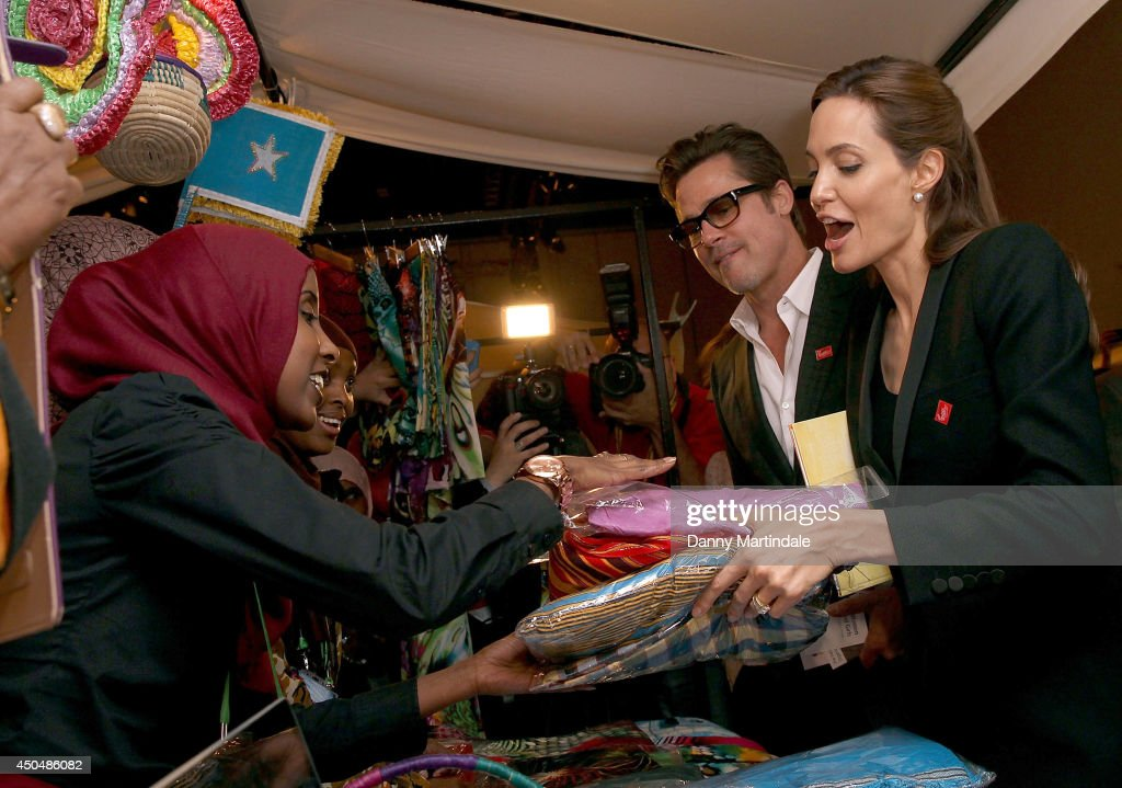 <a gi-track='captionPersonalityLinkClicked' href=/galleries/search?phrase=Brad+Pitt+-+Actor&family=editorial&specificpeople=201682 ng-click='$event.stopPropagation()'>Brad Pitt</a> and US actress and UN special envoy <a gi-track='captionPersonalityLinkClicked' href=/galleries/search?phrase=Angelina+Jolie&family=editorial&specificpeople=201591 ng-click='$event.stopPropagation()'>Angelina Jolie</a> look and shops at one of the stalls during the Global Summit to end Sexual Violence in Conflict at ExCel on June 12, 2014 in London, England.