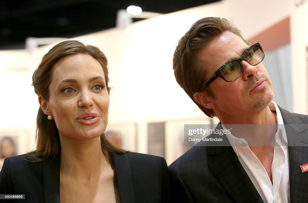 <a gi-track='captionPersonalityLinkClicked' href=/galleries/search?phrase=Brad+Pitt+-+Actor&family=editorial&specificpeople=201682 ng-click='$event.stopPropagation()'>Brad Pitt</a> and US actress and UN special envoy <a gi-track='captionPersonalityLinkClicked' href=/galleries/search?phrase=Angelina+Jolie&family=editorial&specificpeople=201591 ng-click='$event.stopPropagation()'>Angelina Jolie</a> look at some of the art work on show at the Global Summit to end Sexual Violence in Conflict at ExCel on June 12, 2014 in London, England.