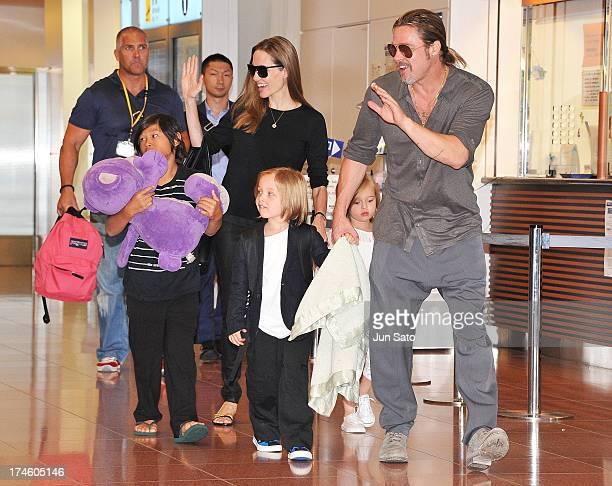 Brad Pitt Angelina Jolie and their children Pax Knox and Vivienne arrive at Tokyo International Airport on July 28 2013 in Tokyo Japan