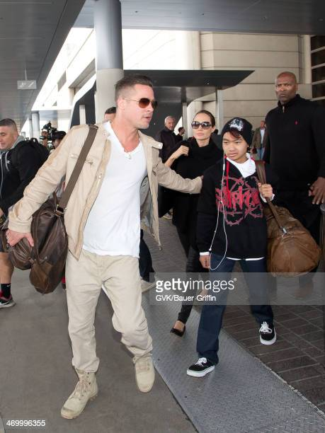 Brad Pitt Angelina Jolie and their son Maddox JoliePitt are seen at Los Angeles International airport on February 17 2014 in Los Angeles California