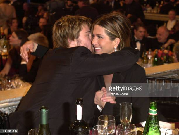 Brad Pitt hugs Jennifer Aniston at the Golden Globe Awards at the Beverly Hilton January 20 2002 in Beverly Hills California