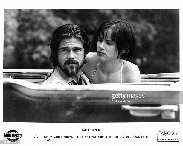 Brad Pitt in car with his girlfriend Juliette Lewis in a scene from the film 'Kalifornia' 1993
