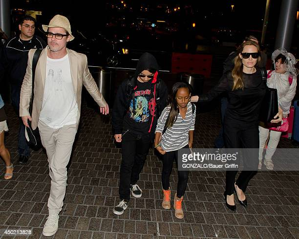 Brad Pitt Maddox JoliePitt Zahara JoliePitt and Angelina Jolie are seen at LAX on June 06 2014 in Los Angeles California