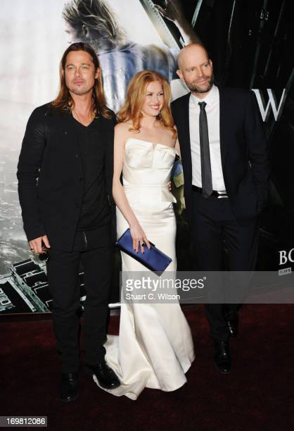 Brad Pitt Mireille Enos and director Marc Forster attend the World Premiere of 'World War Z' at The Empire Cinema on June 2 2013 in London England