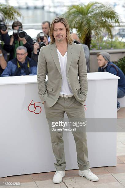 Brad Pitt poses at the 'Killing Them Softly' photocall during the 65th Annual Cannes Film Festival at Palais des Festivals on May 22 2012 in Cannes...