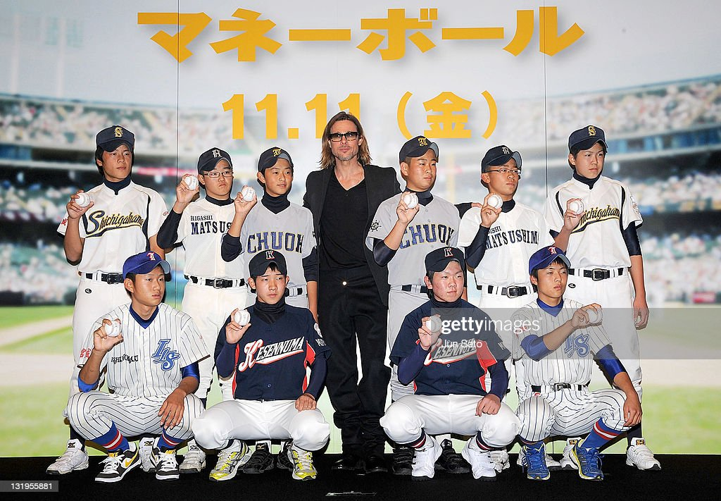 Brad Pitt poses for a photograph with children from a local school which was affected by the tsunami earlier this year, during the premier of 'Moneyball' at Tokyo International Forum on November 9, 2011 in Tokyo, Japan. The film will open on November 11 in Japan.