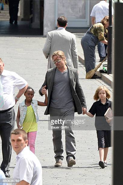 Brad Pitt seen at the Kremlin with his daughters Zahara Pitt and Shiloh Pitt on June 21 2013 in Moscow Russia