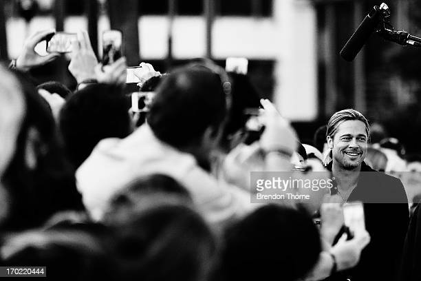 Brad Pitt signs autographs for fans at the 'World War Z' Australian Premiere at the Star on June 9 2013 in Sydney Australia