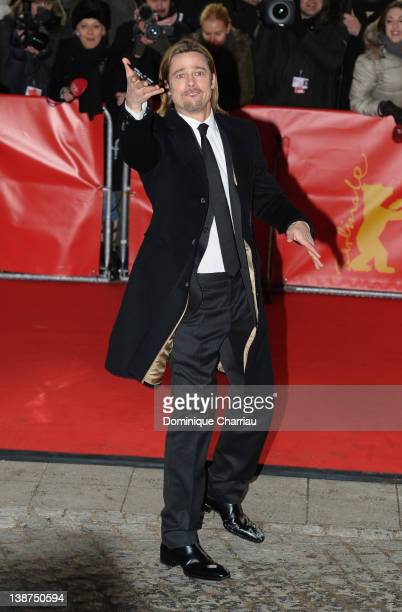 Brad Pitt throws a pen back to a fan as he attends the 'In The Land Of Blood And Honey' Premiere during day three of the 62nd Berlin International...