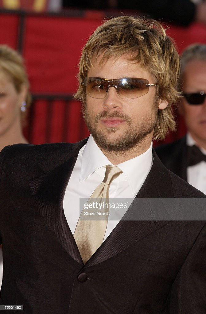 Brad Pitt wearing Burberry 8933S sunglasses arrives at the Golden Globe Awards at the Beverly Hilton January 20, 2002 in Beverly Hills, California.