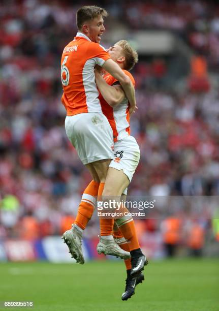 Brad Potts and Will Aimson of Blackpool celebrate victory and promotion after the Sky Bet League Two Playoff Final between Blackpool and Exeter City...