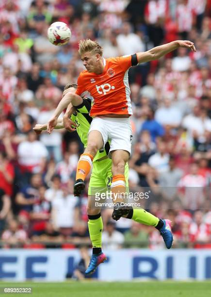 Brad Potts of Blackpool and Jake Taylor of Exeter City battle to win a header during the Sky Bet League Two Playoff Final between Blackpool and...