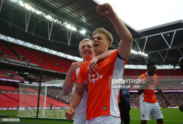 Brad Potts of Blackpool and Mark Cullen of Blackpool celebrate during the Sky Bet League Two Playoff Final match between Blackpool and Exeter City at...
