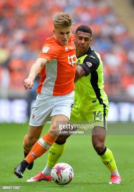 Brad Potts of Blackpool holds off Ollie Watkins of Exeter City during the Sky Bet League Two Playoff Final between Blackpool and Exeter City at...