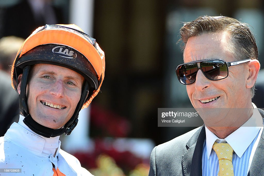 Brad Rawiller and trainer Michael Kent smile after winning the Dover Handicap during Melbourne racing at Flemington Racecourse on January 19, 2013 in Melbourne, Australia.