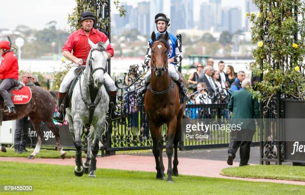 Brad Rawiller returns to the mounting yard on Articus after winning Chairman's Club Handicapat Flemington Racecourse on May 06 2017 in Flemington...