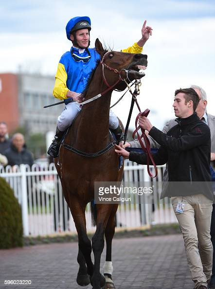 Brad Rawiller riding Black Heart Bart after winning Race 7 New Zealand Bloodstock Memsie Stakes during Melbourne Racing at Caulfield Racecourse on...