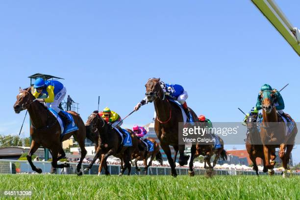 Brad Rawiller riding Black Heart Bart defeats Craig Williams riding Tosen Stardom in Race 5 Futurity Stakes during Melbourne Racing at Caulfield...