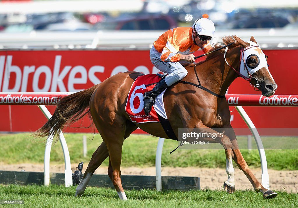 Brad Rawiller riding Burning Front wins Race 8, the T.S Carlyon Cup during Melbourne Racing at Caulfield Racecourse on February 13, 2016 in Melbourne, Australia.
