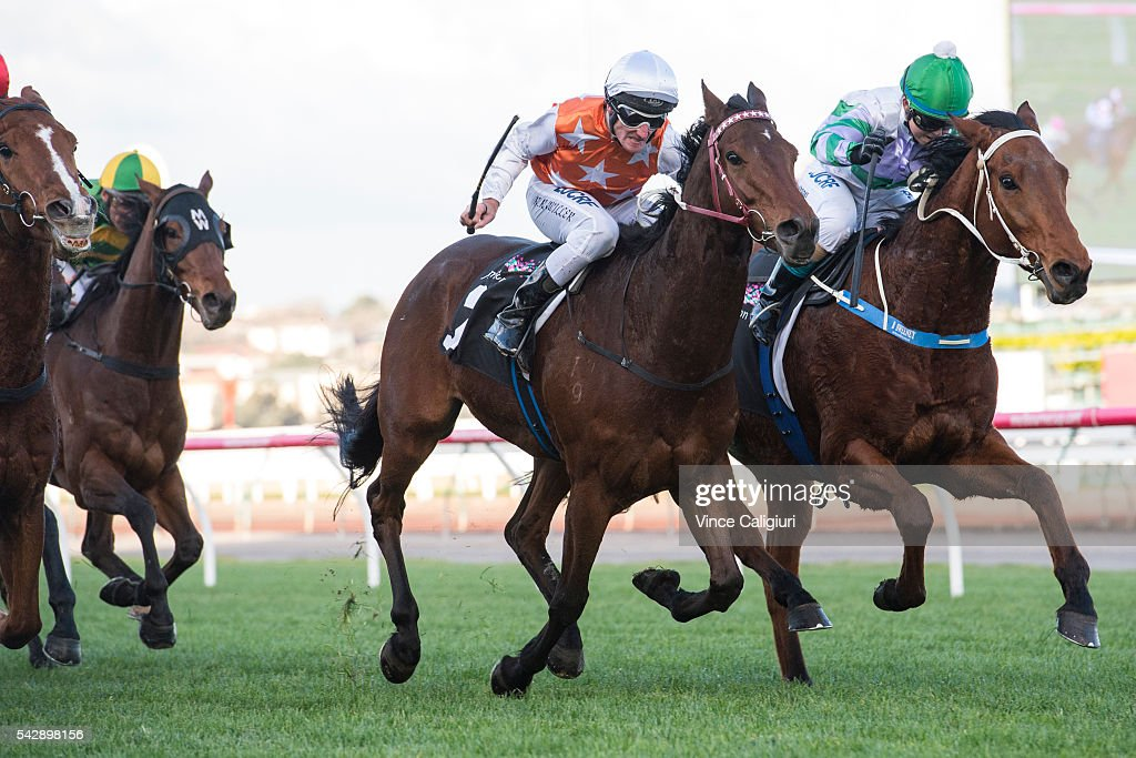 Brad Rawiller riding Royal Rapture defeats Brooke Sweeney riding Leveraction in Race 7, during Melbourne Racing at Flemington Racecourse on June 25, 2016 in Melbourne, Australia.
