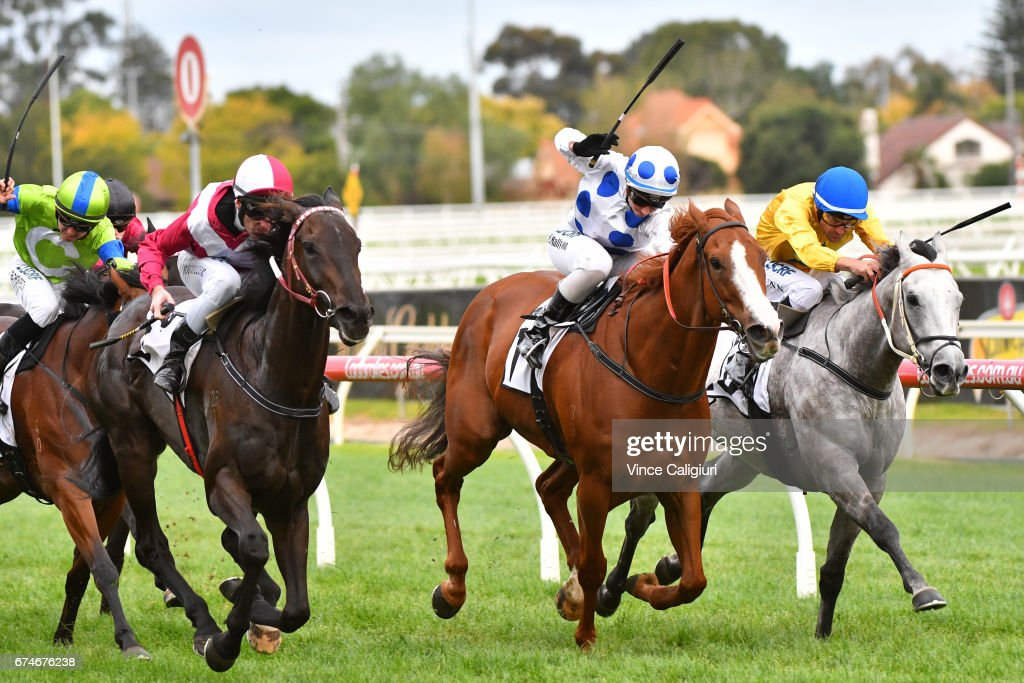 Brad Rawiller riding Star Exhibit (L) defeats Katelyn Mallyon riding Charmed Harmony and Dwayne Dunn riding Top Me Up in Race 8 Thoroughbred Club Stakes during Melbourne Racing at Caulfield Racecourse on April 29, 2017 in Melbourne, Australia.