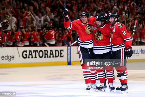 Brad Richards of the Chicago Blackhawks celebrates a first period goal with Duncan Keith and Marian Hossa against the Tampa Bay Lightning during Game...