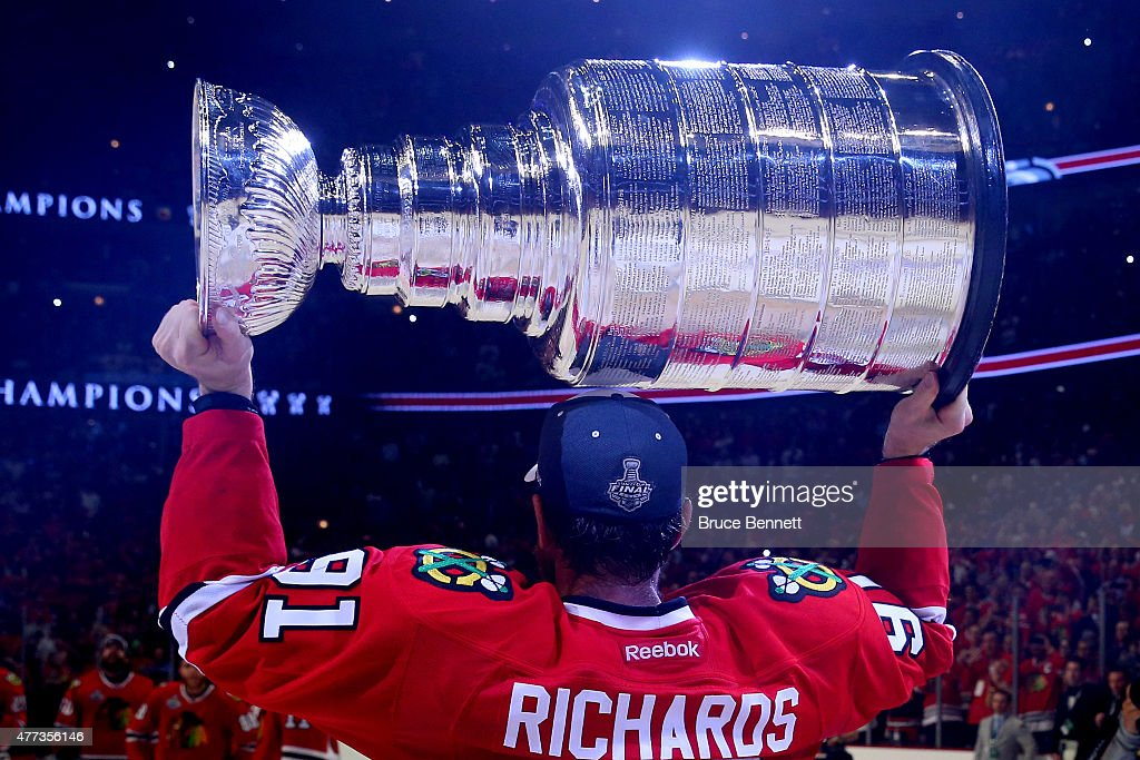 Brad Richards of the Chicago Blackhawks celebrates by hoisting the Stanley Cup after defeating the Tampa Bay Lightning by a score of 20 in Game Six...