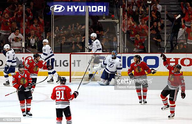 Brad Richards of the Chicago Blackhawks celebrates with teammates after scoring a first period goal against the Tampa Bay Lightning during Game Three...