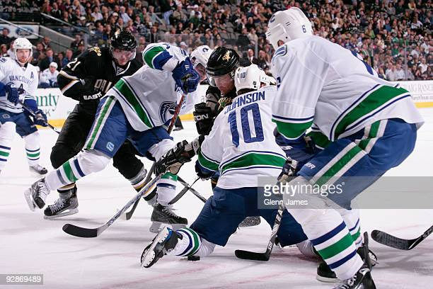 Brad Richards of the Dallas Stars is knocked of the puck by Sami Salo and Ryan Johnson of the Vancouver Canucks on November 6 2009 at the American...