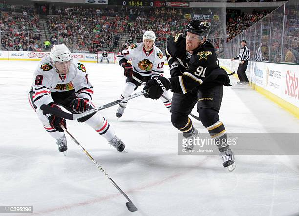 Brad Richards of the Dallas Stars makes a pass to a teammate against Nick Leddy and Ryan Johnson of the Chicago Blackhawks at the American Airlines...