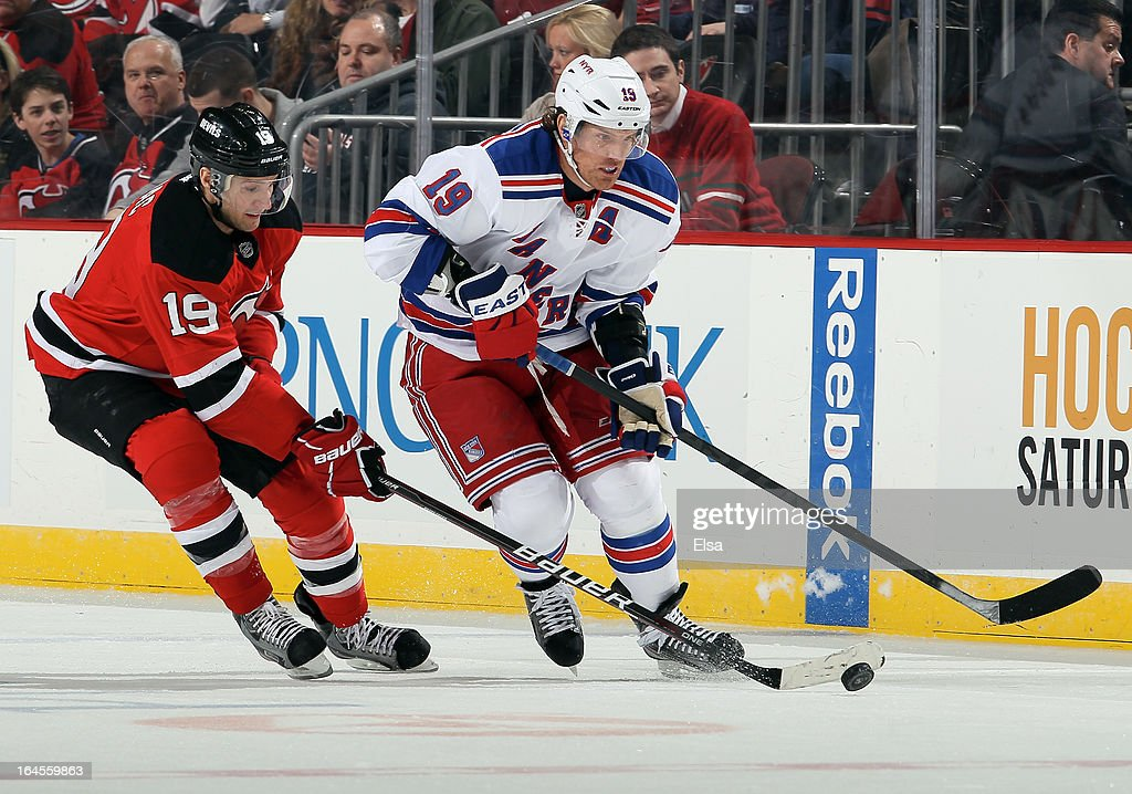 <a gi-track='captionPersonalityLinkClicked' href=/galleries/search?phrase=Brad+Richards&family=editorial&specificpeople=202622 ng-click='$event.stopPropagation()'>Brad Richards</a> #19 of the New York Rangers and <a gi-track='captionPersonalityLinkClicked' href=/galleries/search?phrase=Travis+Zajac&family=editorial&specificpeople=864182 ng-click='$event.stopPropagation()'>Travis Zajac</a> #19 of the New Jersey Devils fight for the puck at the Prudential Center on March 19, 2013 in Newark, New Jersey.