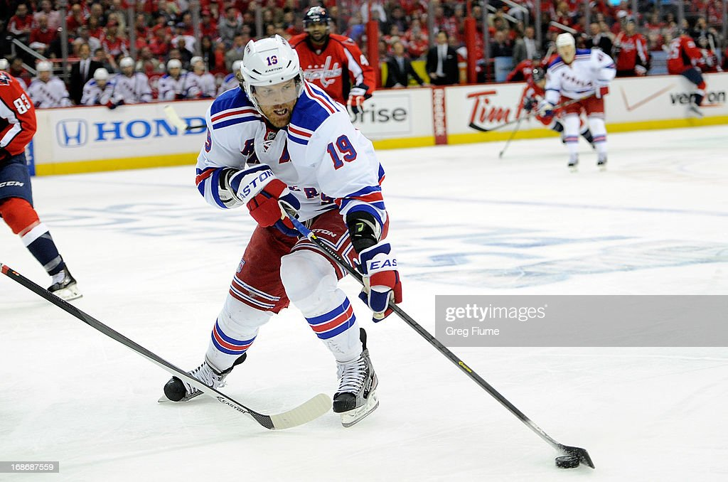 <a gi-track='captionPersonalityLinkClicked' href=/galleries/search?phrase=Brad+Richards&family=editorial&specificpeople=202622 ng-click='$event.stopPropagation()'>Brad Richards</a> #19 of the New York Rangers brings the puck down the ice against the Washington Capitals in Game Seven of the Eastern Conference Quarterfinals during the 2013 NHL Stanley Cup Playoffs at the Verizon Center on May 13, 2013 in Washington, DC.