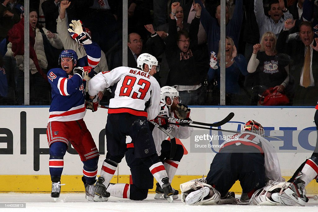 <a gi-track='captionPersonalityLinkClicked' href=/galleries/search?phrase=Brad+Richards&family=editorial&specificpeople=202622 ng-click='$event.stopPropagation()'>Brad Richards</a> #19 of the New York Rangers celebrates after scoring a goal to tie up the game late in the third period against Braden Holtby #70 of the Washington Capitals in Game Five of the Eastern Conference Semifinals during the 2012 NHL Stanley Cup Playoffs at Madison Square Garden on May 7, 2012 in New York City.
