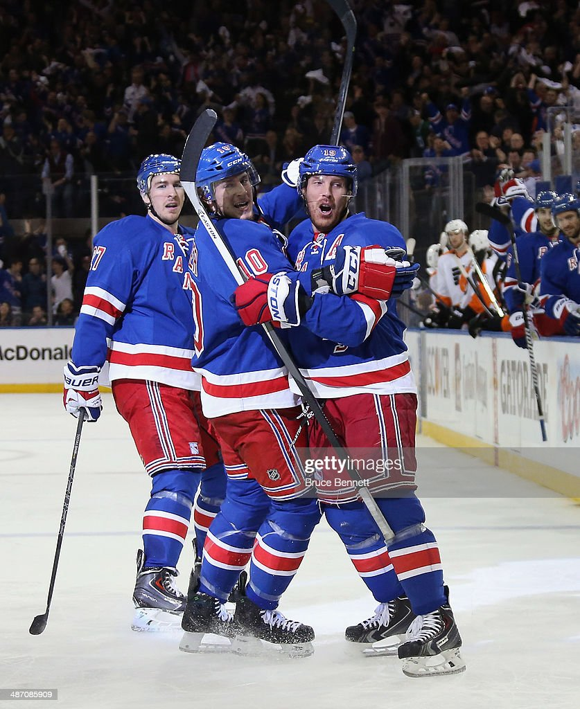 Brad Richards of the New York Rangers celebrates his second period goal along with JT Miller against the Philadelphia Flyers in Game Five of the...