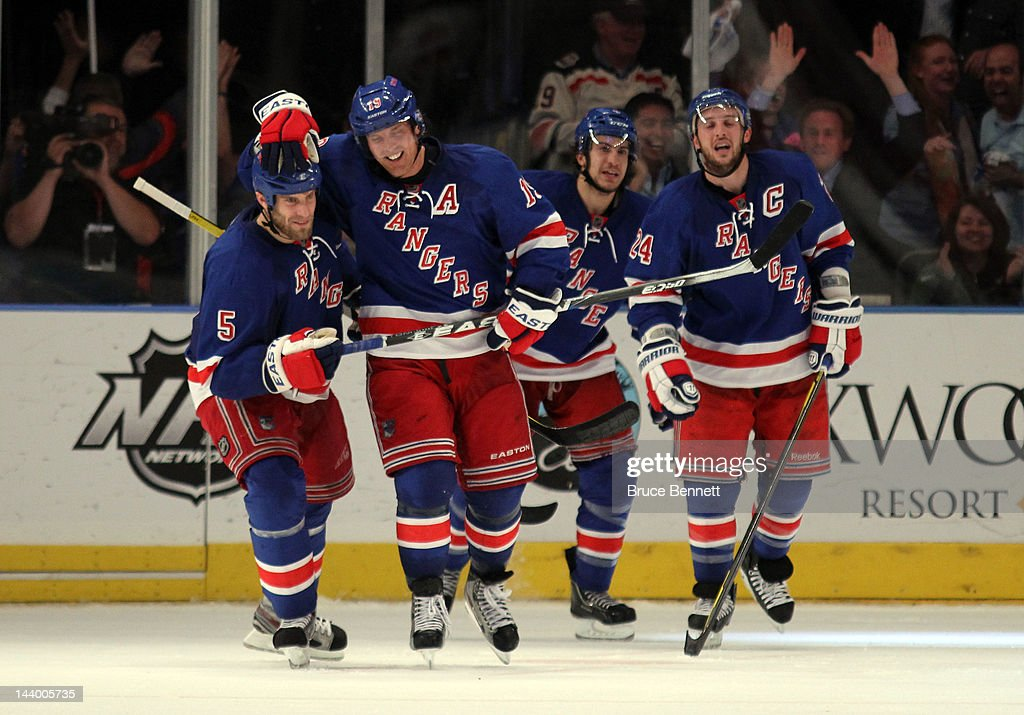 <a gi-track='captionPersonalityLinkClicked' href=/galleries/search?phrase=Brad+Richards&family=editorial&specificpeople=202622 ng-click='$event.stopPropagation()'>Brad Richards</a> #19 of the New York Rangers celebrates with teammate Dan Girardi #5 after scoring a goal to tie up the game late in the third period against Braden Holtby #70 of the Washington Capitals in Game Five of the Eastern Conference Semifinals during the 2012 NHL Stanley Cup Playoffs at Madison Square Garden on May 7, 2012 in New York City.