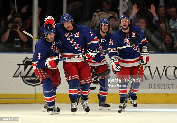 Brad Richards of the New York Rangers celebrates with teammate Dan Girardi after scoring a goal to tie up the game late in the third period against...