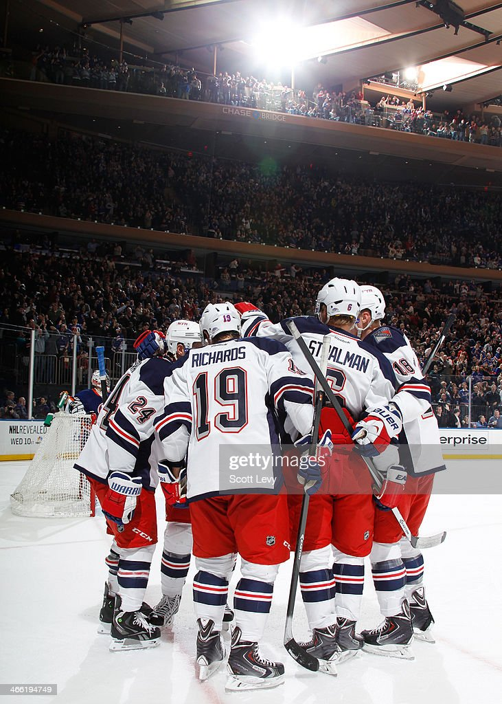 <a gi-track='captionPersonalityLinkClicked' href=/galleries/search?phrase=Brad+Richards&family=editorial&specificpeople=202622 ng-click='$event.stopPropagation()'>Brad Richards</a> #19 of the New York Rangers celebrates with teammates following a third period goal against the New York Islanders at Madison Square Garden on January 31, 2014 in New York City.