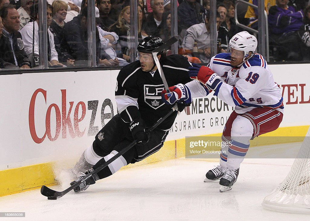 <a gi-track='captionPersonalityLinkClicked' href=/galleries/search?phrase=Brad+Richards&family=editorial&specificpeople=202622 ng-click='$event.stopPropagation()'>Brad Richards</a> #19 of the New York Rangers checks <a gi-track='captionPersonalityLinkClicked' href=/galleries/search?phrase=Drew+Doughty&family=editorial&specificpeople=2085761 ng-click='$event.stopPropagation()'>Drew Doughty</a> #8 of the Los Angeles Kings near the end boards in the first period of their NHL game at Staples Center on October 7, 2013 in Los Angeles, California. The Rangers defeated the Kings 3-1.