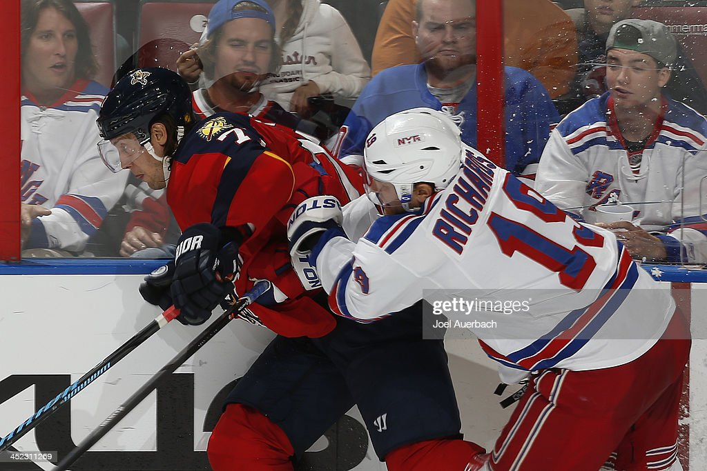 <a gi-track='captionPersonalityLinkClicked' href=/galleries/search?phrase=Brad+Richards&family=editorial&specificpeople=202622 ng-click='$event.stopPropagation()'>Brad Richards</a> #19 of the New York Rangers checks <a gi-track='captionPersonalityLinkClicked' href=/galleries/search?phrase=Tom+Gilbert&family=editorial&specificpeople=687083 ng-click='$event.stopPropagation()'>Tom Gilbert</a> #77 of the Florida Panthers during third period action at the BB&T Center on November 27, 2013 in Sunrise, Florida. The Rangers defeated the Panthers 5-2.