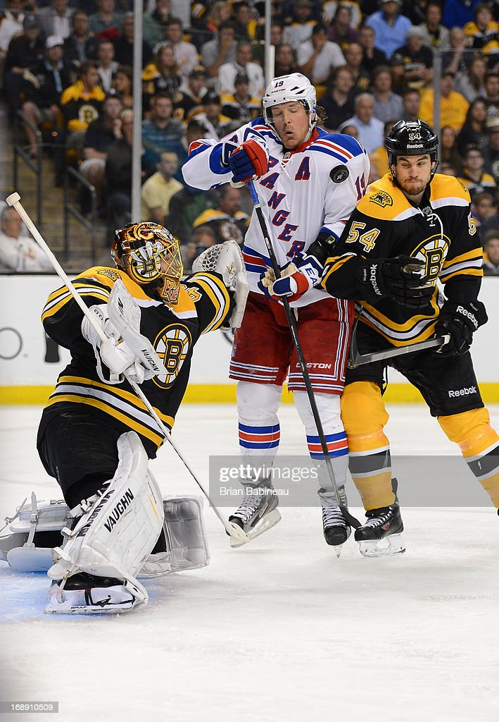 <a gi-track='captionPersonalityLinkClicked' href=/galleries/search?phrase=Brad+Richards&family=editorial&specificpeople=202622 ng-click='$event.stopPropagation()'>Brad Richards</a> #19 of the New York Rangers deflects the puck against <a gi-track='captionPersonalityLinkClicked' href=/galleries/search?phrase=Tuukka+Rask&family=editorial&specificpeople=716723 ng-click='$event.stopPropagation()'>Tuukka Rask</a> #40 and <a gi-track='captionPersonalityLinkClicked' href=/galleries/search?phrase=Adam+McQuaid&family=editorial&specificpeople=2238883 ng-click='$event.stopPropagation()'>Adam McQuaid</a> #54 of the Boston Bruins in Game One of the Eastern Conference Semifinals during the 2013 NHL Stanley Cup Playoffs at TD Garden on May 16, 2013 in Boston, Massachusetts.