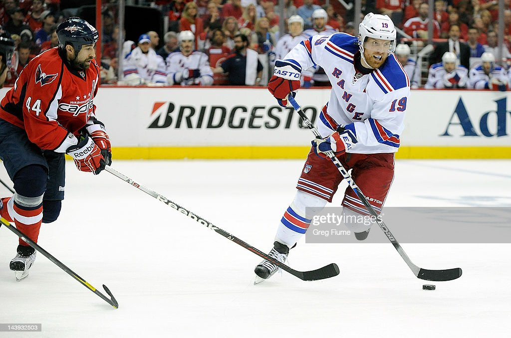 <a gi-track='captionPersonalityLinkClicked' href=/galleries/search?phrase=Brad+Richards&family=editorial&specificpeople=202622 ng-click='$event.stopPropagation()'>Brad Richards</a> #19 of the New York Rangers handles the puck against <a gi-track='captionPersonalityLinkClicked' href=/galleries/search?phrase=Roman+Hamrlik&family=editorial&specificpeople=202069 ng-click='$event.stopPropagation()'>Roman Hamrlik</a> #44 of the Washington Capitals in Game Four of the Eastern Conference Semifinals during the 2012 NHL Stanley Cup Playoffs at the Verizon Center on May 5, 2012 in Washington, DC.