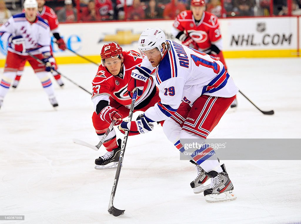 <a gi-track='captionPersonalityLinkClicked' href=/galleries/search?phrase=Brad+Richards&family=editorial&specificpeople=202622 ng-click='$event.stopPropagation()'>Brad Richards</a> #19 of the New York Rangers protects the puck from <a gi-track='captionPersonalityLinkClicked' href=/galleries/search?phrase=Jeff+Skinner&family=editorial&specificpeople=3147596 ng-click='$event.stopPropagation()'>Jeff Skinner</a> #53 of the Carolina Hurricanes during play at the RBC Center on March 1, 2012 in Raleigh, North Carolina.