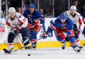 Brad Richards of the New York Rangers reaches for the puck against Alexander Semin of the Washington Capitals in Game Two of the Eastern Conference...