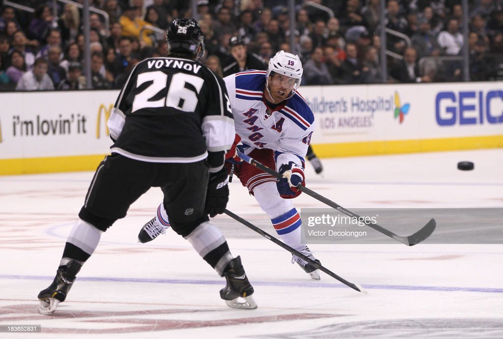 <a gi-track='captionPersonalityLinkClicked' href=/galleries/search?phrase=Brad+Richards&family=editorial&specificpeople=202622 ng-click='$event.stopPropagation()'>Brad Richards</a> #19 of the New York Rangers shoots the puck into the corner in the third period of their NHL game against the Los Angeles Kings at Staples Center on October 7, 2013 in Los Angeles, California. The Rangers defeated the Kings 3-1.